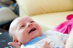 Six week baby smile. Happy six week baby smiling in mother's hands royalty free stock photos