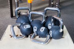 Six weights in the gym. Dumbbells of different weight lie and stand. royalty free stock photo