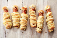 Six Weiners Wrapped in Pastry to Look Like Mummies Stock Photos
