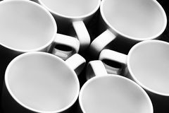 Six white cups in a circle Stock Images