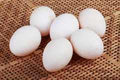 Eggs on basketry Royalty Free Stock Image