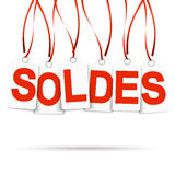 Six white hangtags with SOLDES. Six white hang tags with red letters soldes Stock Photos