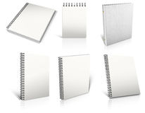 Six white spiral blank notepad on white. Stock Photo
