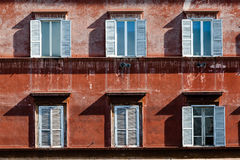 Six windows of an ancient building in Rome, Italy. stock photos