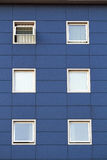 Six windows on a blue building Stock Photo