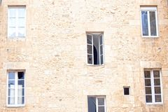 Six windows in a wall, some of them open. Some closed Stock Photography