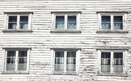 Six windows in a white wooden house Stock Photo