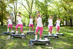 Six women doing exercises outdoor Stock Photos
