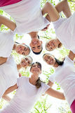 Six women standing with their heads in circle Stock Photo