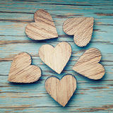 Six wooden hearts placed nicely on a turquoise vintage wood Stock Photography