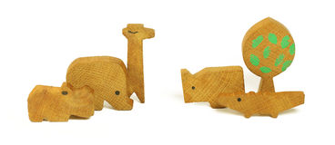 Six wooden toys in the form of a tree and the African animals Royalty Free Stock Photography