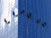 Six workers washing windows stock photo