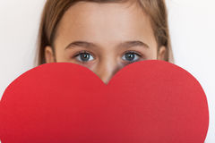Six-Year Girl Hold Big Red Heart. Cute Beautiful Six-Year Girl Hold Big Red Heart, Smiling And Looking At Camera, On White Background. / Little Girl Give Red Stock Image
