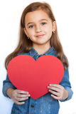 Six-Year Girl Hold Big Red Heart. Cute Beautiful Six-Year Girl Hold Big Red Heart, Smiling And Looking At Camera, On White Background. / Little Girl Give Red Royalty Free Stock Photography