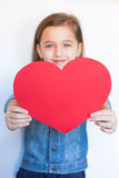 Six-Year Girl Hold Big Red Heart. Happy Six-Year Girl Hold Big Red Heart On White Background. / Little Girl Give Red Heart For Valentine`s Day. Selective Focus Stock Photography
