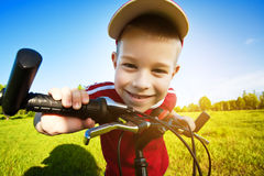 Six year old boy on a bike Stock Image