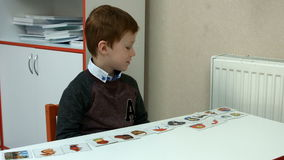 Six-year-old boy in class stock video footage