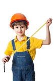 Six-year-old boy dressed as construction worker with tape measure. Isolated on white background Royalty Free Stock Image