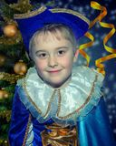 Six year old funny cute boy in the blue musketeer suit. Portret. Closeup Royalty Free Stock Image