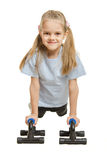 Six year old girl athlete is pushed via the stops Royalty Free Stock Images
