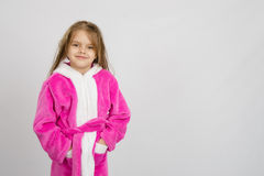 Six year old girl in bathrobe, a place under an inscription Royalty Free Stock Photo
