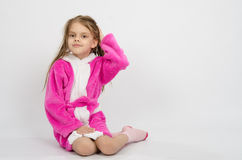 Six year old girl in a bathrobe straightens hair Royalty Free Stock Image