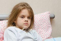 Six year old girl in bed temperature of Stock Photo