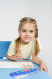 Six year old girl draws paints the sun Royalty Free Stock Image