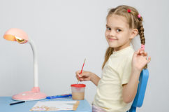 Six year old girl draws paints and waves Royalty Free Stock Photo