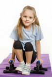 Six year old girl hanging on the palm pushups Stock Photo