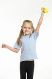 Six year old girl held up a dumbbell Stock Photo