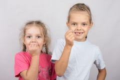 Six year old girl showing her teeth, four-year girl afraid of toothache Stock Photo
