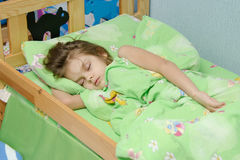 Six year old girl sleeping in bed Royalty Free Stock Photo