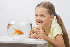 Six year old girl very happy donated her gold fish Royalty Free Stock Images