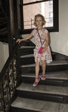 Six year old girl walking down stairs Royalty Free Stock Images