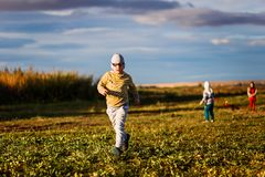 Six-year-old kid running on the grass stock photos