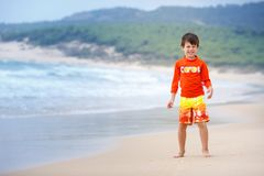 Six years old boy playing on exotic beach Royalty Free Stock Images