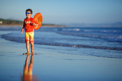 Six years old boy with swimtrainer on exotic beach Stock Image