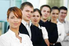 Six young business persons standing in a row royalty free stock images