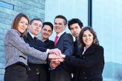 Six young businessperson holding hands together Royalty Free Stock Images