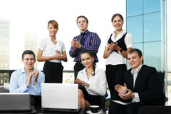 Six young businesspersons are clapping their hands Royalty Free Stock Photos