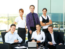 Six young businesspersons in formal clothes Stock Image