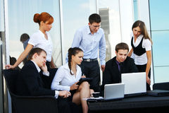 Six young businesspersons working together Royalty Free Stock Image