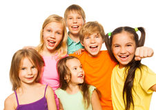 Six young children on a white background. Six young children hug and smile on a white background Royalty Free Stock Photos