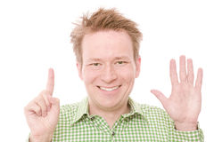 Six. Young happy smiling man showing the number six on his fingers - isolated on white and retouched (As this is part of a series going from 1 to 10, you can Stock Image