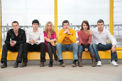 Six young persons sit Royalty Free Stock Image
