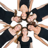Six young women laying in circle Royalty Free Stock Photos