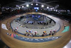 Sixday cycling series finals in palma velodrome. Cyclists ride during their final race at the Sixday cycling event finals in Palmaarena velodrome in the Spanish stock images