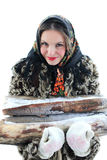 At sixes and sevens, inharmoniously. Girl with firewood. Russian village. Winter.Canon 5Dmark2 Royalty Free Stock Image