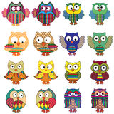 Sixteen cartoon ornate funny owls Stock Images